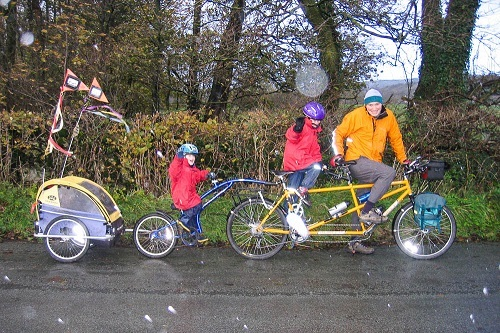 Family On Bikes With Bike Trailer