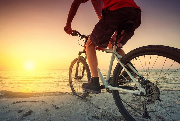 Ride on bike on the beach.